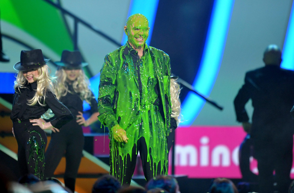 . Pitbull is slimed at the 26th annual Nickelodeon\'s Kids\' Choice Awards on Saturday, March 23, 2013, in Los Angeles. (Photo by John Shearer/Invision/AP)