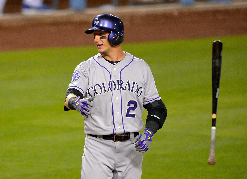 . Colorado Rockies\' Troy Tulowitzki tosses his bat after striking out during the second inning of their baseball game against the Los Angeles Dodgers, Wednesday, May 1, 2013, in Los Angeles. (AP Photo/Mark J. Terrill)