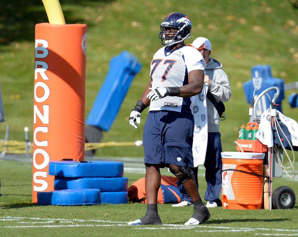 . Denver Broncos Winston Justice (77) watches drills during practice October 16, 2013 at Dove Valley. (Photo by John Leyba/The Denver Post)