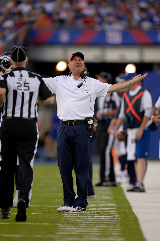 . EAST RUTHERFORD , NJ -SEPTEMBER 15: Denver Broncos head coach John Fox reacts for a penalty as he looks at the replay on the scoreboard during the third quarter September 15, 2013 MetLife Stadium. (Photo by John Leyba/The Denver Post)