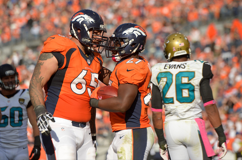 . Denver Broncos running back Knowshon Moreno (27) and Denver Broncos offensive guard Justin Boren (65) celebrate a touchdown run in the third quarter. T  (Photo by Joe Amon/The Denver Post)