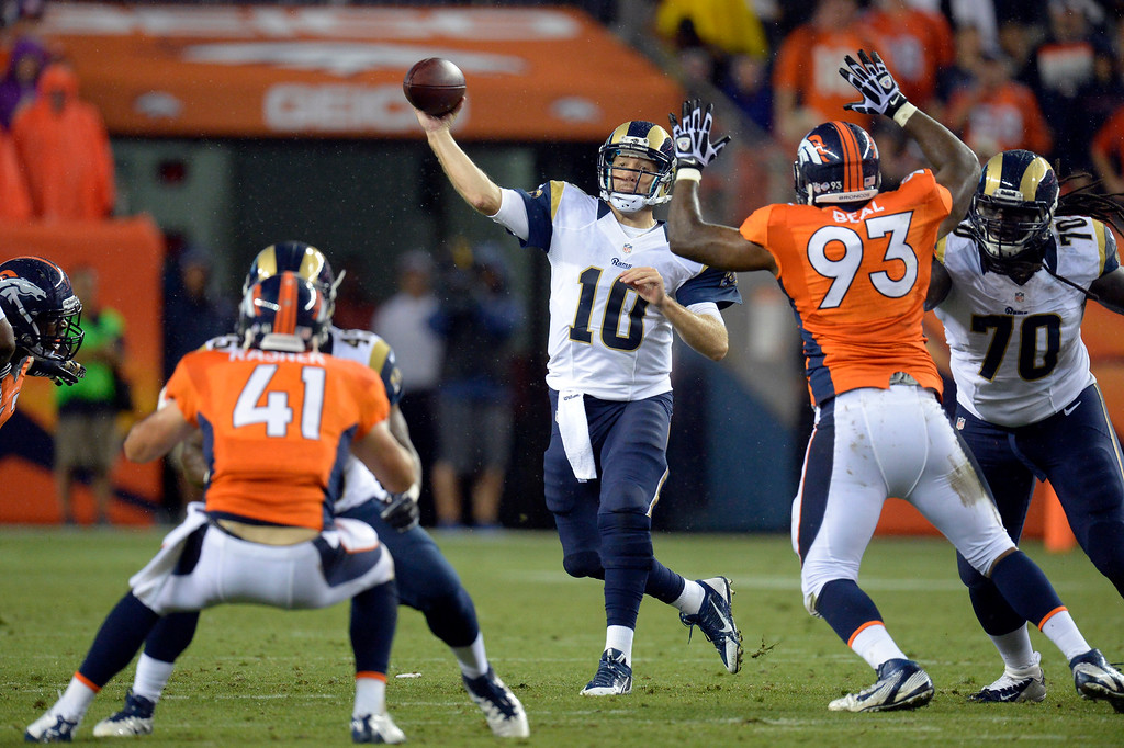 . DENVER, CO. - AUGUST 17: St. Louis Rams quarterback Kellen Clemens (10) throws a pass over Denver Broncos defensive end Jeremy Beal (93) during the fourth quarter August 24, 2013 at Sports Authority Field at Mile High. (Photo By John Leyba/The Denver Post)
