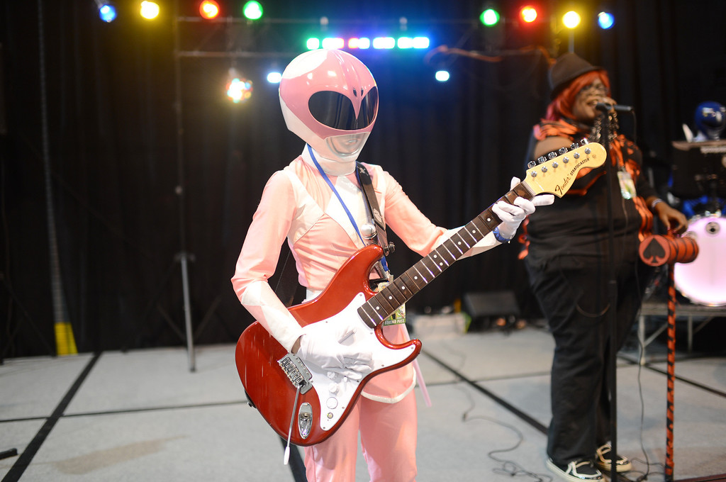 . DENVER, CO. - MAY 31: Misty Shaeffer, 22, of Colorado Springs plays guitar with Power Ranger costume during the opening day of Denver Comic Con at Colorado Convention Center. Denver, Colorado. May 31, 2013. (Photo By Hyoung Chang/The Denver Post)