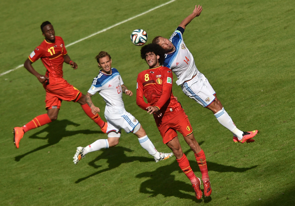 . Belgium\'s midfielder Marouane Fellaini (2R) and Russia\'s defender Vasily Berezutsky (R) challenge for the ball as Russia\'s defender Andrei Yeshchenko (2L) and Belgium\'s forward Divock Origi (L) look on during the Group H football match between Belgium and Russia at The Maracana Stadium in Rio de Janeiro on June 22, 2014, during the 2014 FIFA World Cup.   YASUYOSHI CHIBA/AFP/Getty Images
