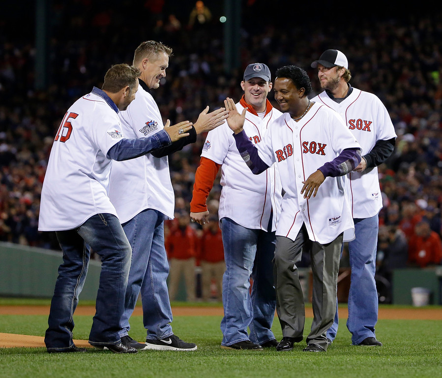 . Boston Red Sox\'s Pedro Martinez, right front, greets former teammates before Game 2 of baseball\'s World Series between the Boston Red Sox and the St. Louis Cardinals Thursday, Oct. 24, 2013, in Boston. (AP Photo/Matt Slocum)