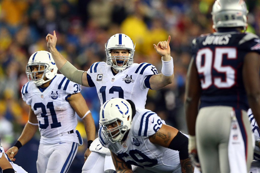 . FOXBORO, MA - JANUARY 11:  Andrew Luck #12 of the Indianapolis Colts calls a play against the New England Patriots during the AFC Divisional Playoff game at Gillette Stadium on January 11, 2014 in Foxboro, Massachusetts.  (Photo by Elsa/Getty Images)