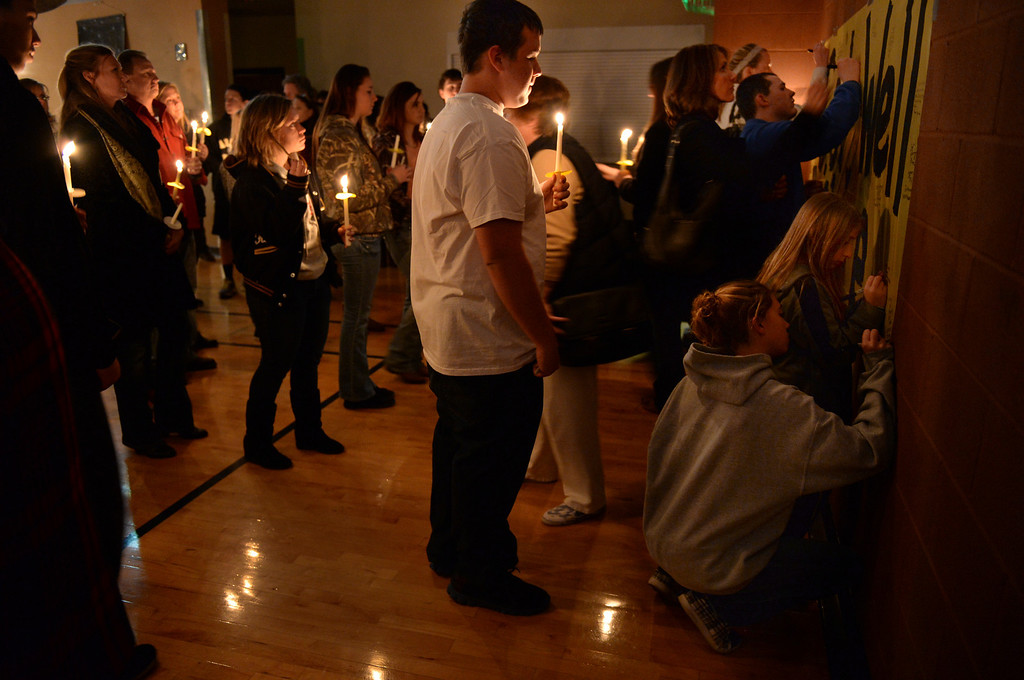 . CENTENNIAL, CO. - DECEMBER 20:  People waited in line to sign a get-well card for Claire Davis following a candlelight vigil Friday night. Reverend Bradley Stoltenow led a candlelight vigil for Claire Davis at Shepherd of the Hills Lutheran Church December 20, 2013. Photo By Karl Gehring/The Denver Post