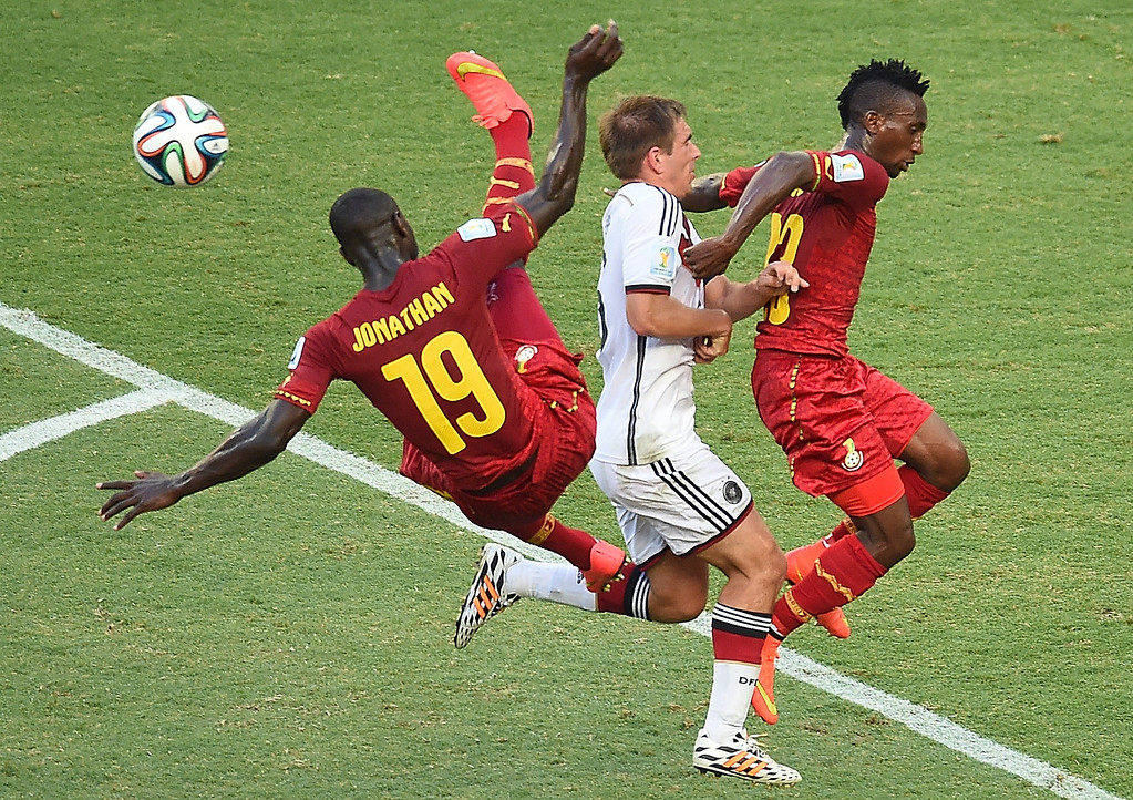 . Germany\'s defender and captain Philipp Lahm (C) vies with Ghana\'s defender Jonathan Mensah (L) and Ghana\'s defender Harrison Afful during a Group G football match between Germany and Ghana at the Castelao Stadium in Fortaleza during the 2014 FIFA World Cup on June 21, 2014. EMMANUEL DUNAND/AFP/Getty Images