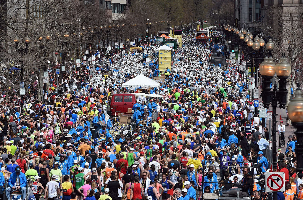 . Runners mill about on Boylston Street street after completing of the 118th Boston Marathon in Boston, Massachusetts April 21, 2014. Meb Keflezighi became the first American male athlete since Greg Meyer in 1983 to win the Boston Marathon on Monday while Kenya\'s Rita Jeptoo won her second women\'s title in a row and third overall.  AFP PHOTO / Timothy A. CLARY/AFP/Getty Images
