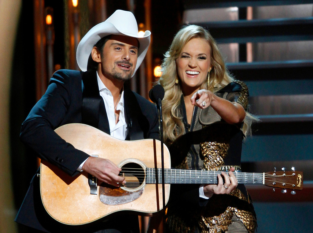 . Co-hosts Brad Paisley, left, and Carrie Underwood perform at the 47th annual CMA Awards at Bridgestone Arena on Wednesday, Nov. 6, 2013, in Nashville, Tenn. (Photo by Wade Payne/Invision/AP)