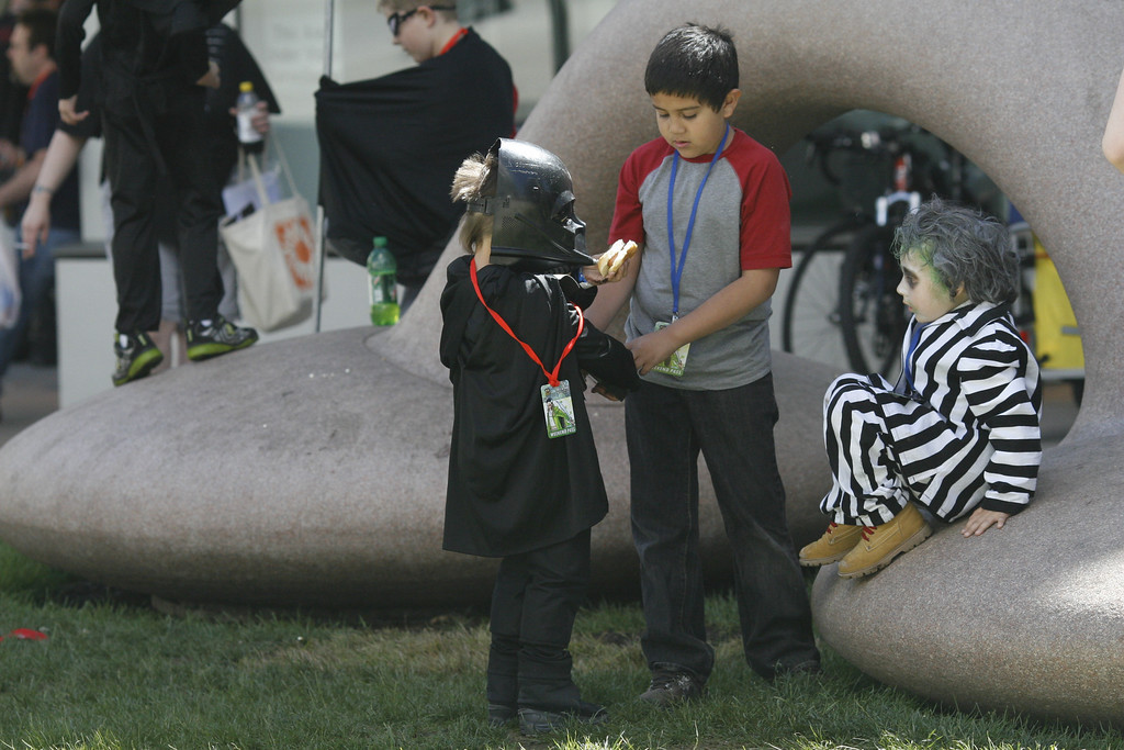 . DENVER, COLORADO - JUNE 1: Max Barela, 4, is attending his second Denver Comic Con, this year dressed as Beetlejuice from the 1988 Tim Burton film. Other costumed children flicked to concrete sculptures outside the Convention Center on Saturday, June 1, 2013. The Denver Comic Con is at the Colorado Convention Center May 31 through June 2, 2013. (Photo by Daniel J. Schneider/The Denver Post)