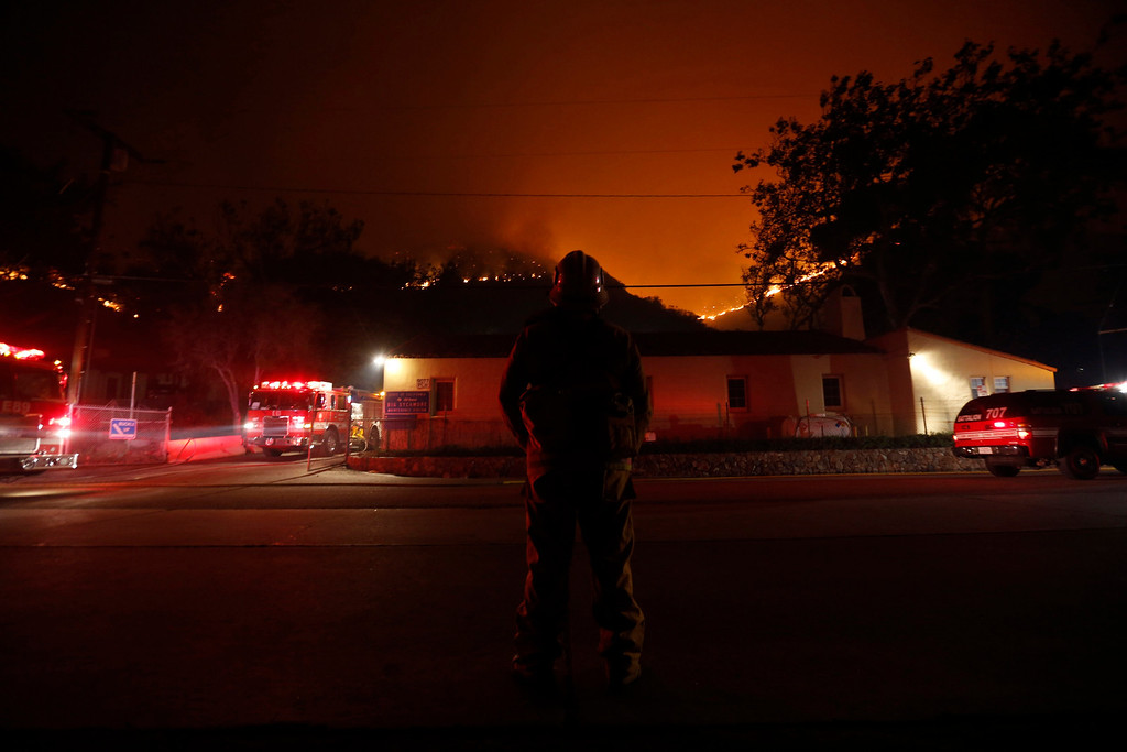 . Firefighters battle to protect the Sycamore Nature Center and a CalTrans Maintenance Station and Fuel Depot from The Springs Fire near Pacific Coast Highway and the Los Angeles County Line at Malibu, California, May 2, 2013. REUTERS/Patrick T. Fallon