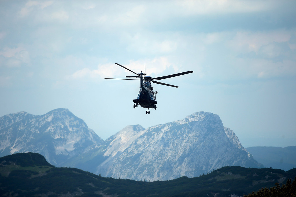 . A police rescue helicopter arrives near the entrance to the Riesending vertical cave during the final phase of the transport of injured spelunker Johann Westhauser to the surface on June 19, 2014 near Marktschellenberg, Germany.  (Photo by Johannes Simon/Getty Images)