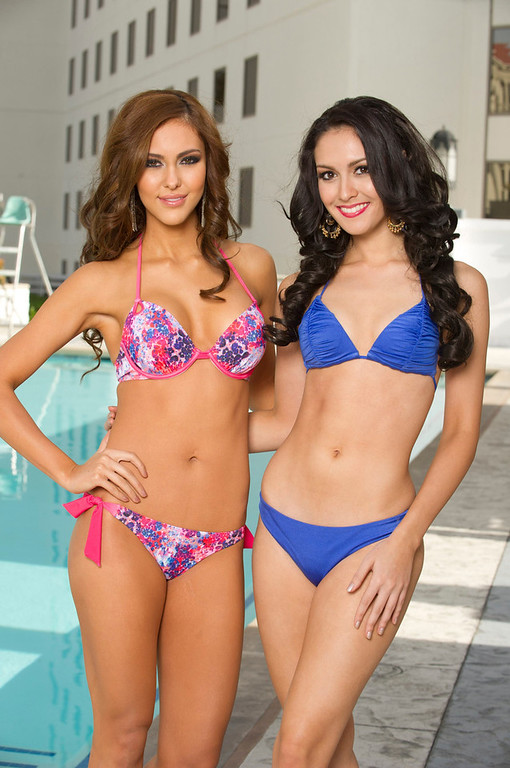 . Miss Universe 2012 contestants Miss Malaysia Kimberley Leggett (L) and Miss Thailand Nutpimon Farida Waller pose for photos in their swimwear at Planet Hollywood Resort and Casino, in Las Vegas, Nevada December 3, 2012. The Miss Universe 2012 competition will be held on December 19. REUTERS/Darren Decker/Miss Universe Organization L.P/Handout