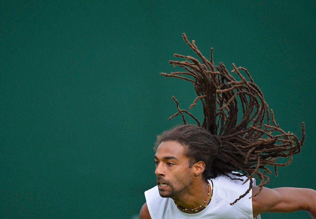 . Dustin Brown of Germany serves to Guillermo Garcia-Lopez of Spain in their men\'s singles tennis match at the Wimbledon Tennis Championships, in London June 24, 2013.  REUTERS/Toby Melville