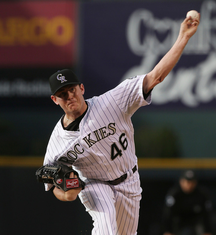 . Colorado Rockies starting pitcher Tyler Matzek works against the Atlanta Braves in the first inning of a baseball game in Denver on Wednesday, June 11, 2014. (AP Photo/David Zalubowski)