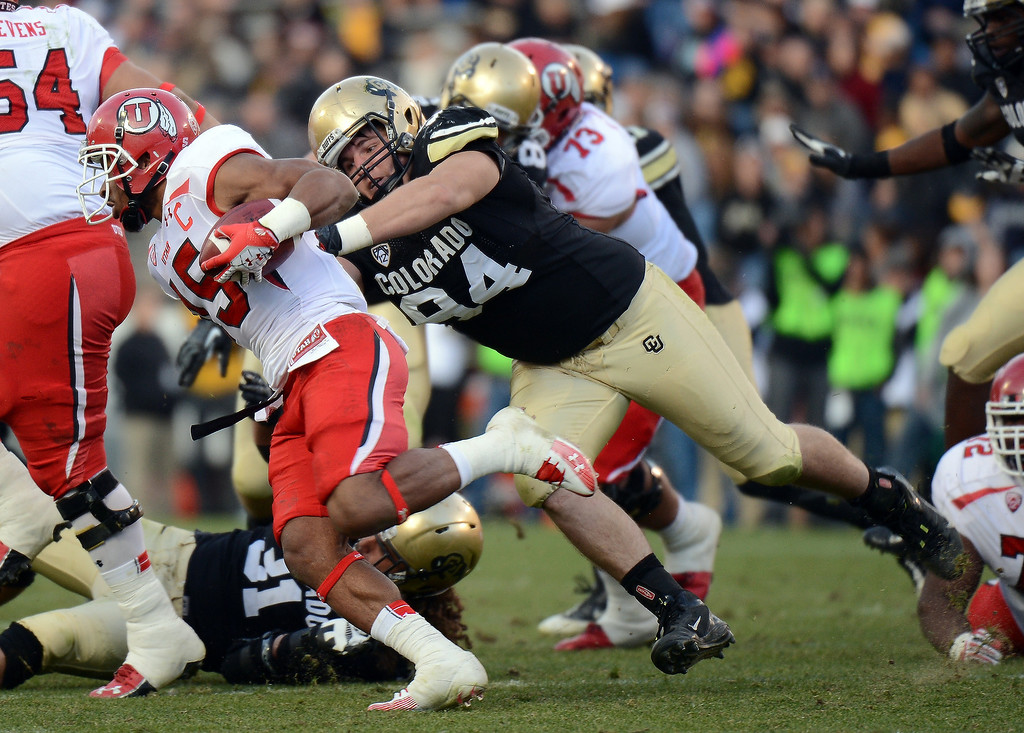. University of Colorado\'s Tyler Hennington, right, tackles Utah running back John White at Folsom Field on November 23, 2012.  Hyoung Chang, The Denver Post
