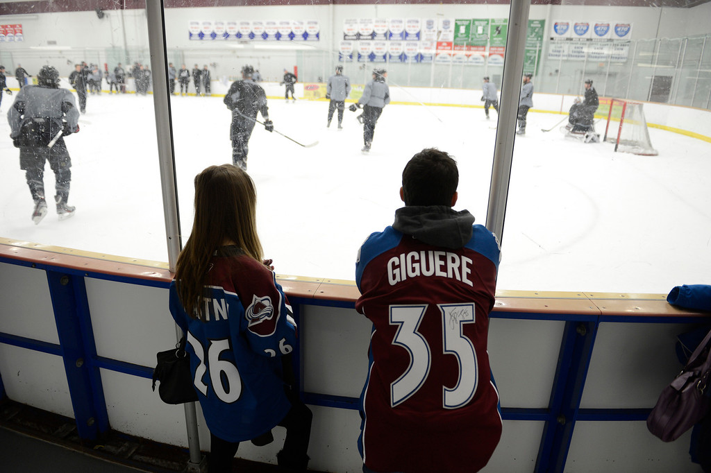 . Jennie Renes 19-years-old with her brtoher Tommy Renes 20-years-old watch the Avalanche practice during training camp  Tuesday, January 15, 2013 at Family Sports Center. John Leyba, The Denver Post