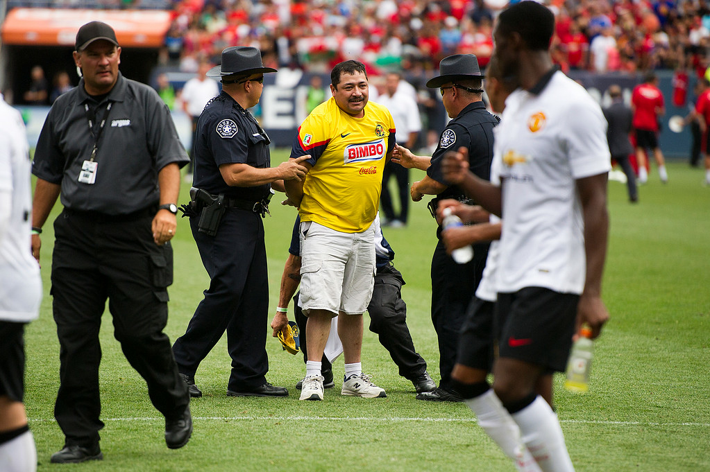 . A fan is arrested after running onto the field following the conclusion of the match between Manchester United and AS Roma during an exhibition match of the Guinness International Champions Cup at Sports Authority Field at Mile High on July 26, 2014, in Denver, Colorado. Manchester United won 3-2. (Photo by Daniel Petty/The Denver Post)