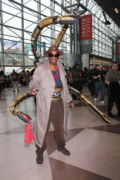 . Fans pose for a photo at the New York Comic Con 2013 - Day 2 at The Jacob K. Javits Convention Center on October 11, 2013 in New York City.  (Photo by Laura Cavanaugh/Getty Images)