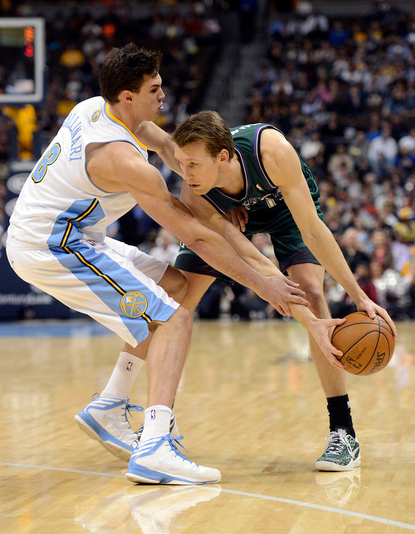 . DENVER, CO. - FEBRUARY 05: Danilo Gallinari (8) of the Denver Nuggets reaches in on Mike Dunleavy (17) of the Milwaukee Bucks during the fourth quarter February 05, 2013 at Pepsi Center. The Denver Nuggets defeated the Milwaukee Bucks 112-104 in NBA action. (Photo By John Leyba/The Denver Post)