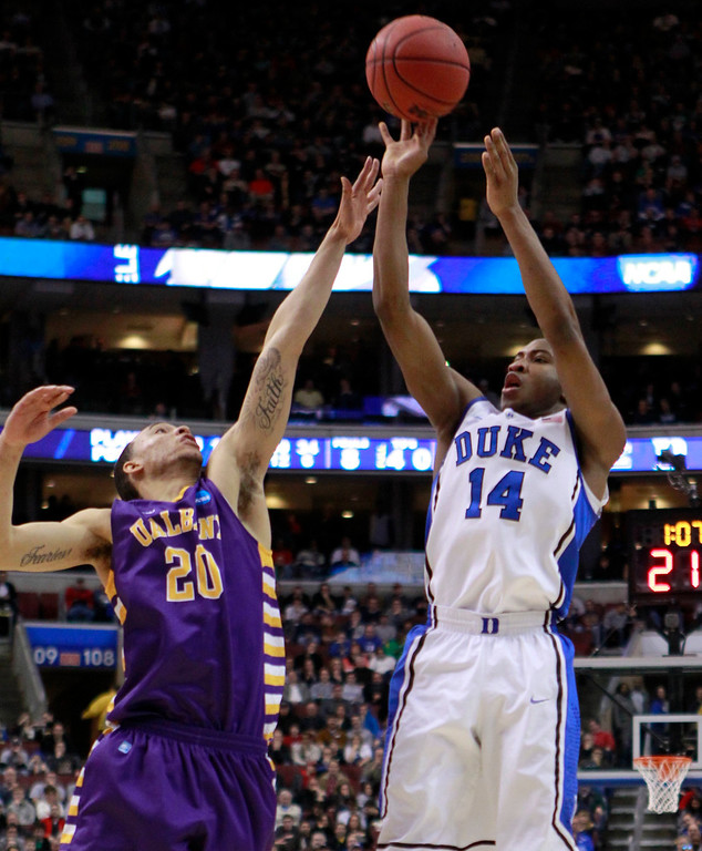 . Duke Blue Devils\' Rasheed Sulaimon (14) shoots over the defense of Albany Great Danes\' Gary Johnson (20) during the first half of their second round NCAA tournament game in Philadelphia, Pennsylvania, March 22, 2013. REUTERS/Tim Shaffer