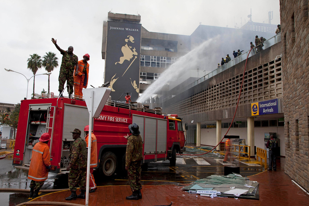 . Firefighters put out the fire which gutted the International arrivals area of Jomo Kenyatta International Airport, Nairobi, Kenya, Aug. 7, 2013.  (AP Photo/Sayyid Azim)