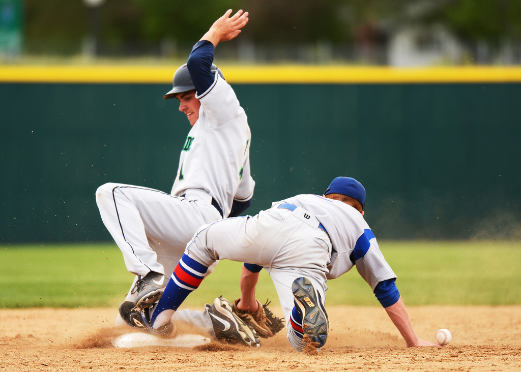 . DENVER, CO. - MAY 24 :Connor Lambert of ThunderRidge High School (1) succeed stealing second base from Ryan Robb of Cherry Creek High School (2) during semifinal round of 5A State Championships baseball game at All City Field. Denver, Colorado. May 24, 2013. ThunderRidge won 5-1. (Photo By Hyoung Chang/The Denver Post)