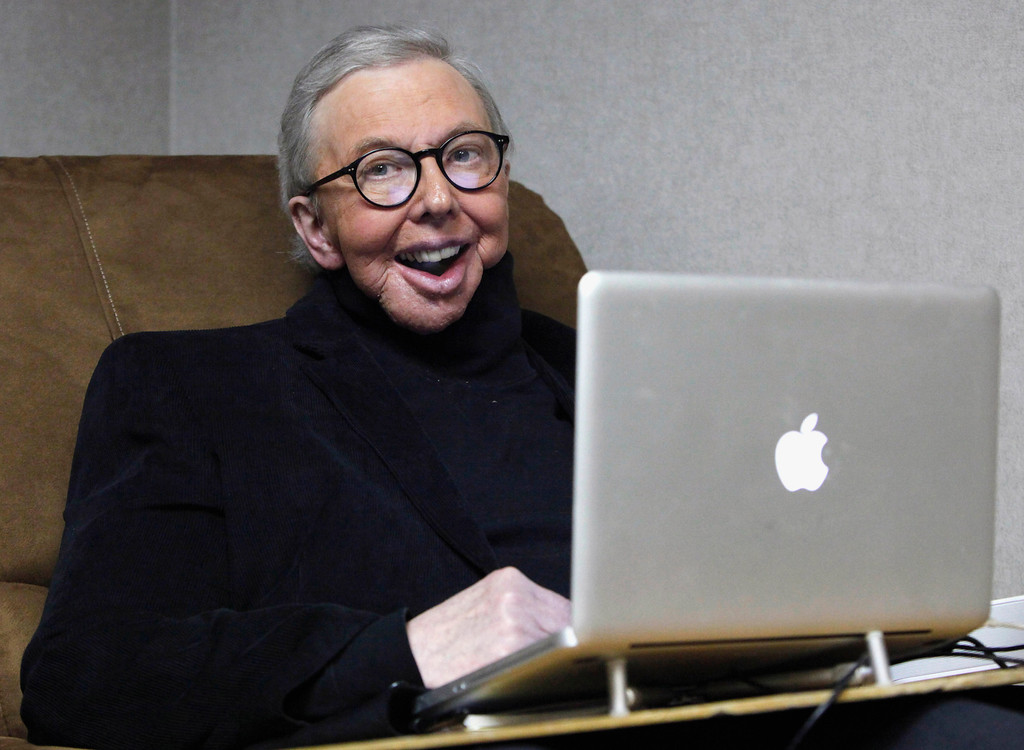 . In this Jan. 12, 2011 file photo, Pulitzer Prize-winning movie critic Roger Ebert works in his office at the WTTW-TV studios in Chicago. The Chicago Sun-Times is reporting that its film critic Roger Ebert died on Thursday, April 4, 2013. He was 70.  (AP Photo/Charles Rex Arbogast, File)