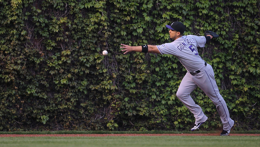 . Colorado Rockies left fielder Carlos Gonzalez reachers for the ball in the first inning on May 15, 2013, against the Chicago Cubs at Wrigley Field in Chicago, Illinois. (Brian Cassella/Chicago Tribune/MCT)