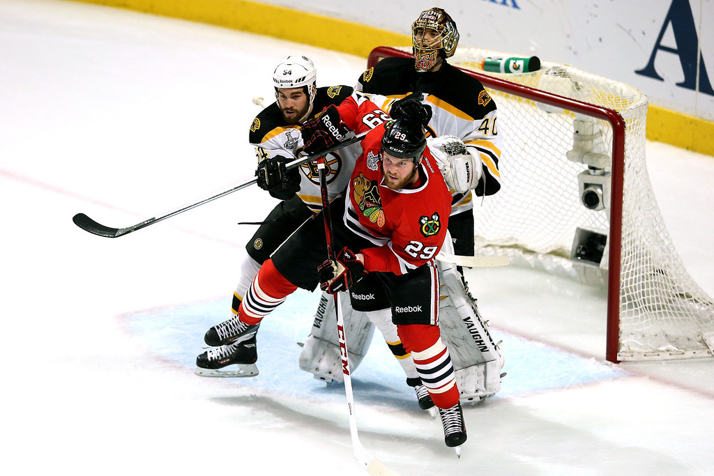 . CHICAGO, IL - JUNE 22:  Adam McQuaid #54 of the Boston Bruins and Bryan Bickell #29 of the Chicago Blackhawks fight for position in fron tof the net in Game Five of the 2013 NHL Stanley Cup Final at United Center on June 22, 2013 in Chicago, Illinois.  (Photo by Jonathan Daniel/Getty Images)
