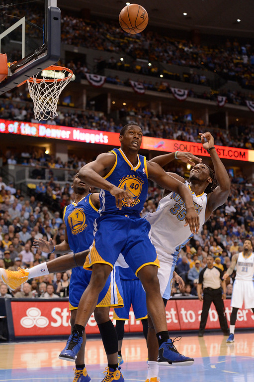 . Denver Nuggets small forward Kenneth Faried (35) battles with Golden State Warriors small forward Harrison Barnes (40) for a rebound in the second quarter. The Denver Nuggets took on the Golden State Warriors in Game 5 of the Western Conference First Round Series at the Pepsi Center in Denver, Colo. on April 30, 2013. (Photo by John Leyba/The Denver Post)