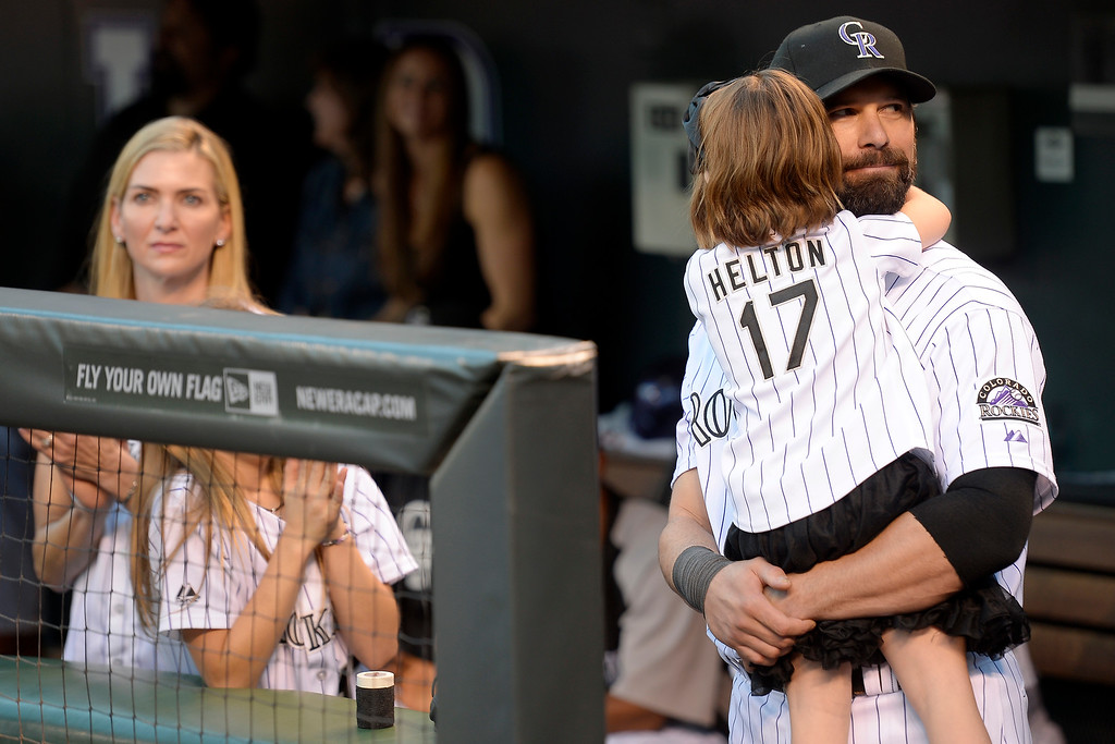 . Todd Helton holds his daughter Gentry Grace before the start of action in Denver. The Colorado Rockies hosted the Boston Red Sox and said farewell to longtime first baseman Todd Helton, who recently announced his retirement following this season. (Photo by John Leyba/The Denver Post)