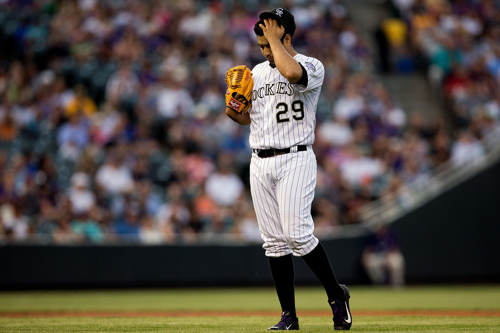 . DENVER, CO - MAY 17:  Starting pitcher Jorge de la Rosa #29 of the Colorado Rockies reacts after giving up a hit during the second inning against the San Francisco Giants at Coors Field on May 17, 2013 in Denver, Colorado.  (Photo by Justin Edmonds/Getty Images)