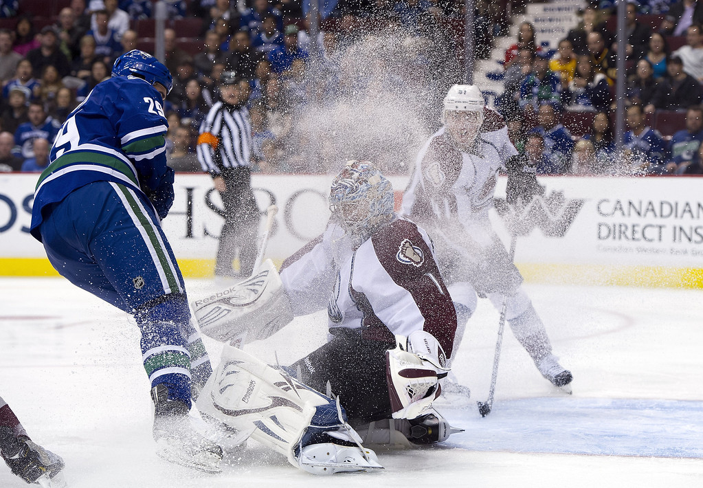 . Tom Sestito #29 of the Vancouver Canucks sprays goalie Semyon Varlamov #1 of the Colorado Avalanche with ice while charging to the front of the net during the second period in NHL action on March 28, 2013 at Rogers Arena in Vancouver, British Columbia, Canada.  (Photo by Rich Lam/Getty Images)