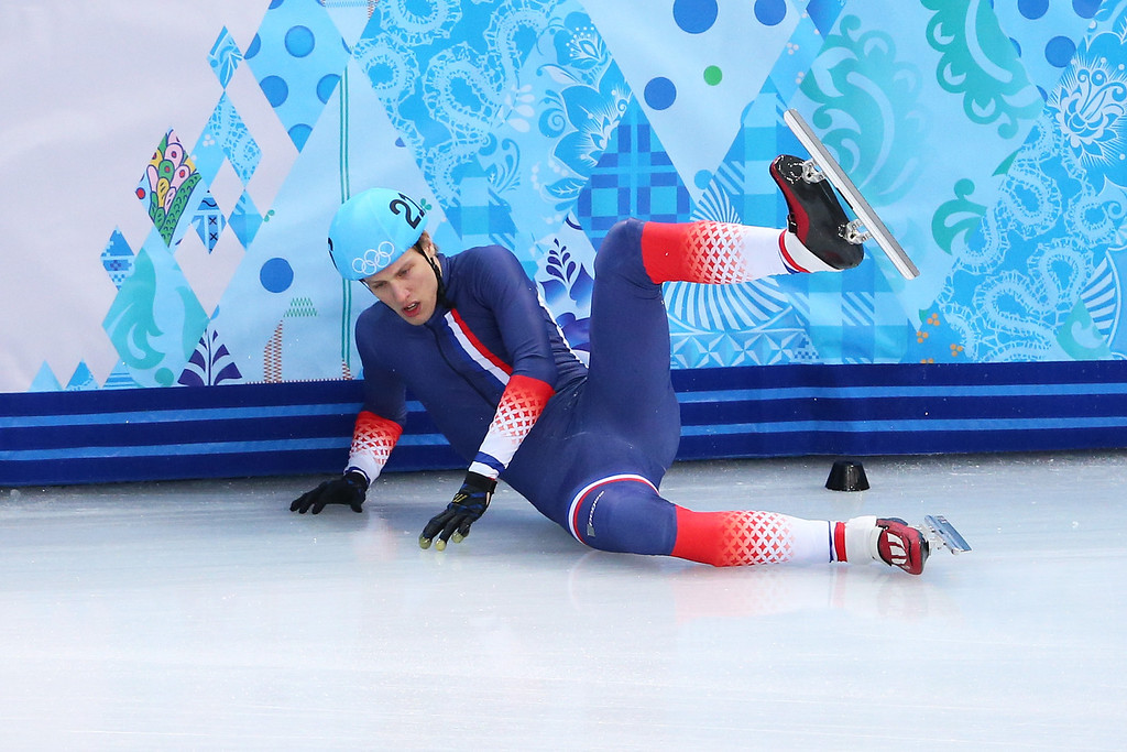 . SOCHI, RUSSIA - FEBRUARY 13:  Sebastien Lepape of France falls as he competes in the Short Track Men\'s 1000m Heats on day 6 of the Sochi 2014 Winter Olympics at at Iceberg Skating Palace on February 13, 2014 in Sochi, Russia.  (Photo by Quinn Rooney/Getty Images)