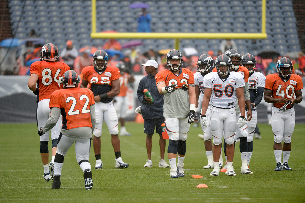 . Denver Broncos practice  during a rain day on day six of the Denver Broncos 2014 training camp July 30, 2014 at Sports Authority Field at Mile High Stadium.  (Photo by John Leyba/The Denver Post)