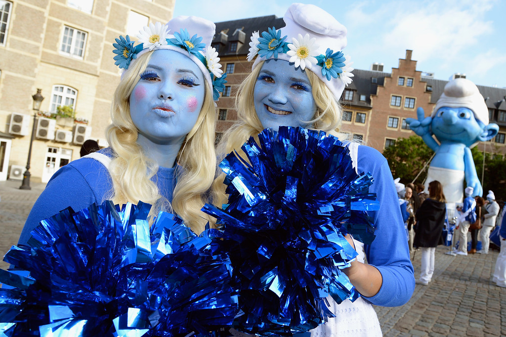 . Smurf Ambassadors pose on Place d\'Espagne during a ceremony as part of Global Smurfs Day celebrations on June 22, 2013 in Brussels, Belgium. (Photo by Pascal Le Segretain/Getty Images for Sony Pictures Entertainment)
