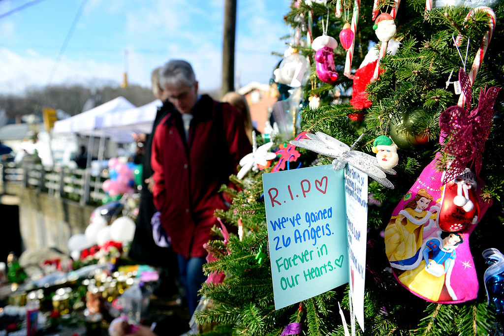 . A card hangs on a Christmas tree as community members remember the victims of the Sandy Hook school shooting in Newtown, Connecticut on Tuesday, December 18, 2012. AAron Ontiveroz, The Denver Post