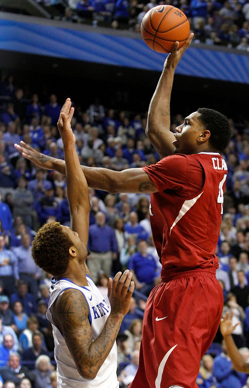 . Arkansas\' Coty Clarke, right, shoots as Kentucky\'s James Young defends during the second half of an NCAA college basketball game, Thursday, Feb. 27, 2014, in Lexington, Ky. Arkansas won 71-67. (AP Photo/James Crisp)