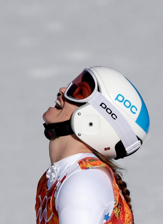 . United States\' Julia Mancuso catches her breath at the end of the women\'s super-G at the Sochi 2014 Winter Olympics, Saturday, Feb. 15, 2014, in Krasnaya Polyana, Russia. (AP Photo/Gero Breloer)
