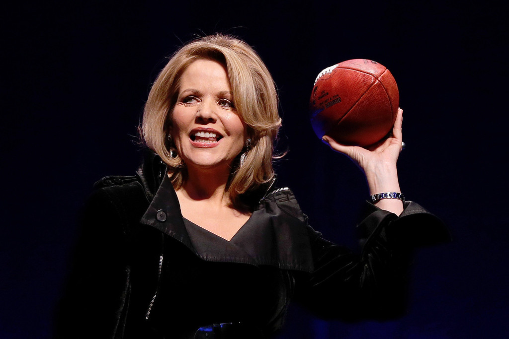 . Opera singer Renee Fleming who will sing the National Anthem before the NFL Super Bowl XLVIII football game holds the game ball during a press conference Thursday, Jan. 30, 2014, in New York. (AP Photo)
