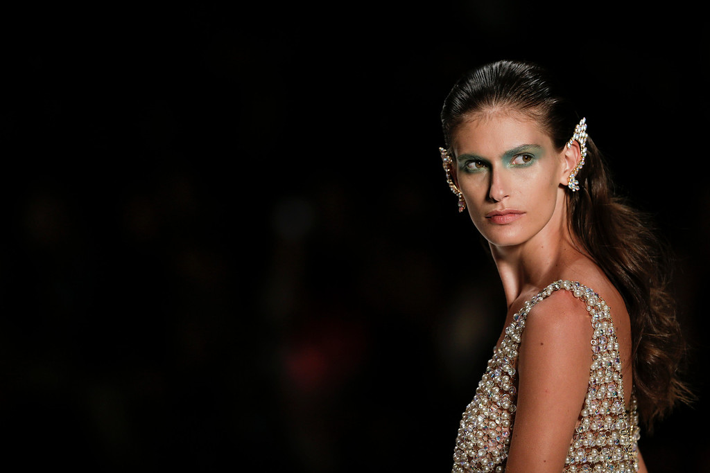 . A model wears a creation from the Victor Dzenk collection during Fashion Week in Rio de Janeiro, Brazil, Thursday, April 10, 2014. (AP Photo/Felipe Dana)