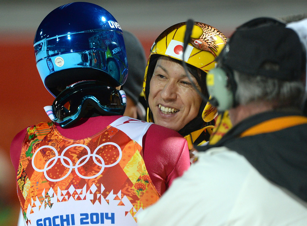 . Silver winner Japan\'s Noriaki Kasai (R) is congratulated by Poland\'s Maciej Kot  in the finish area of the Men\'s Ski Jumping Large Hill Individual Final Round at the RusSki Gorki Jumping Center during the Sochi Winter Olympics on February 15, 2014, in Rosa Khutor. PETER PARKS/AFP/Getty Images