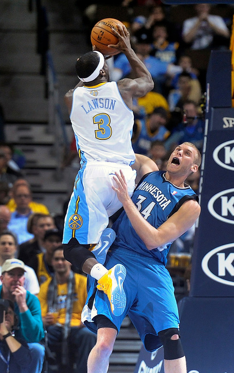 . Denver Nuggets guard Ty Lawson, left, collides with Minnesota Timberwolves center Greg Stiemsma, right, in the first quarter of an NBA basketball game on Saturday, March 9, 2013, in Denver.  (AP Photo/Chris Schneider)