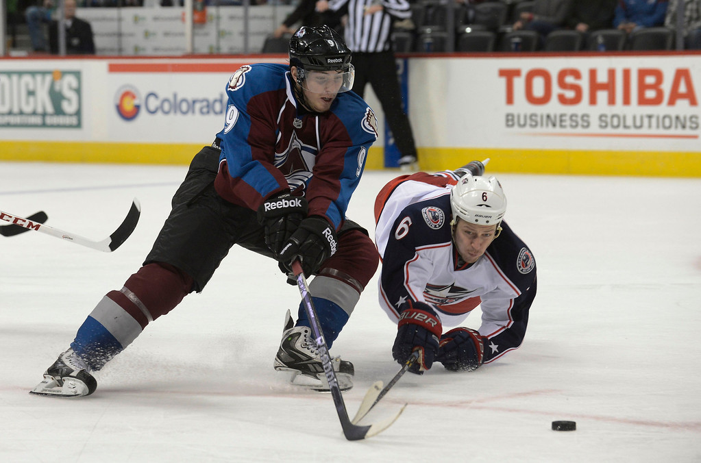 . DENVER, CO. - JANUARY 24: Colorado Avalanche center Matt Duchene (9) chases after the puck as Columbus Blue Jackets defenseman Nikita Nikitin (6) falls to the ice in defense during the third period January 24, 2013 at Pepsi Center. The Colorado Avalanche  defeated the Columbus Blue Jackets 4-0.   (Photo By John Leyba / The Denver Post)