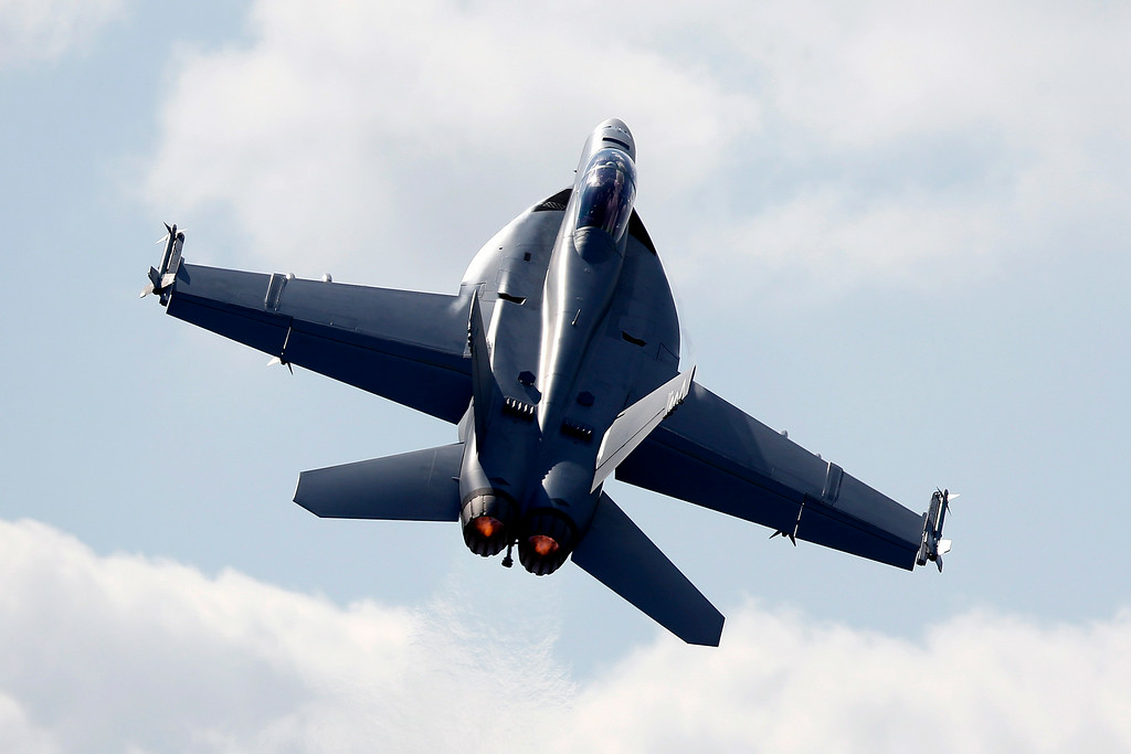 . A Boeing F/A-18 E/F Super Hornet flies on display during Farnborough International Air Show, Farnborough, England, Tuesday, July 15, 2014. (AP Photo/Sang Tan)