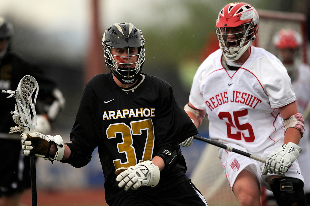 . DENVER, CO - MAY 15: Arapahoe High School junior attacker Brendan Till #37 competes against Regis Jesuit sophomore midfielder Conor Shea #25 during a CHSAA 5A boys lacrosse semifinal game on May 15, 2013, in Denver, Colorado. Arapahoe won 13-5 to advance to the finals. (Photo by Daniel Petty/The Denver Post)