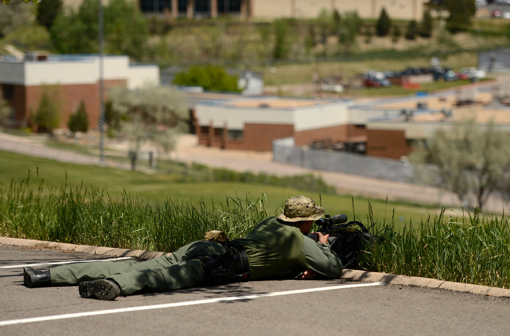 . A police sniper keeps and eye on Thornton High School during a lock down, May 24, 2013. (Photo By RJ Sangosti/The Denver Post)