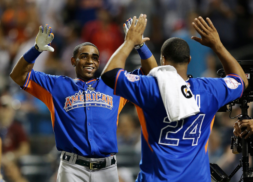 . American League\'s Yoenis Cespedes, left, of the Oakland Athletics, celebrates with Robinson Cano after winning the  MLB All-Star baseball Home Run Derby, on Monday, July 15, 2013 in New York. (AP Photo/Kathy Willens)